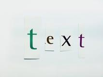 Текст - вырез формулирует коллаж смешанных писем кассеты с белой предпосылкой Стоковое Фото