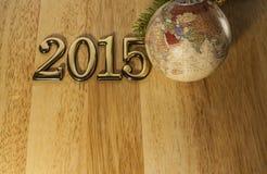 Текст 2015 Новых Годов и безделушка рождества Стоковые Изображения