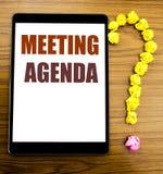 Текст объявления почерка показывая повестку дня заседания Концепция дела для плана план-графика дела написанного на таблетке с де Стоковое фото RF