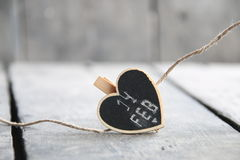 Текст 14-ое февраля, поздравительная открытка дня ` s валентинки St с сердцем, запачкал фото для предпосылки Стоковые Изображения