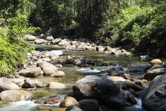 Текущая вода и камни стоковое фото rf