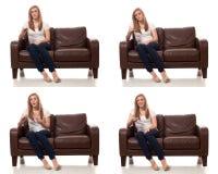 Телевидение молодой женщины наблюдая Стоковая Фотография
