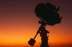 телескоп восхода солнца 4 силуэтов Стоковые Фото