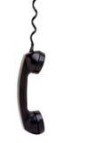 телефонная трубка вися старый телефон Стоковое фото RF