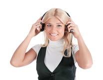 телефоны девушки уха стоковое фото