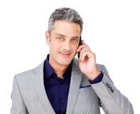 телефон бизнесмена уверенно стоковые изображения rf