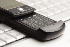 телефон макроса компьтер-книжки клетки Стоковая Фотография