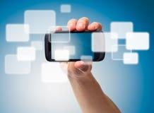 телефон мультимедиа руки стоковое изображение