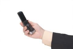 телефон удерживания клетки бизнесмена Стоковое фото RF