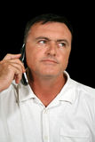 телефон человека клетки заинтересованный Стоковое фото RF