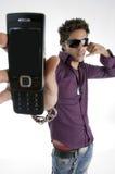 телефон человека клетки показывая белизну Стоковое Изображение
