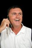 телефон человека клетки смеясь над Стоковые Изображения RF
