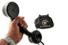 телефон черной руки старый Стоковое Изображение
