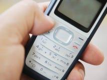 телефон pda удерживания руки клетки Стоковое Изображение RF