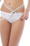 тело она измеряя тонкая женщина Стоковые Фотографии RF