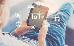 Тема безопасностью IoT при человек используя таблетку стоковые изображения
