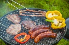 Тема приготовления на гриле с веществом барбекю Стоковые Фото
