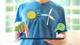 Тема экологичности с человеком используя планшет стоковая фотография rf