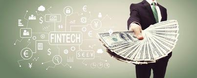 Тема Fintech с бизнесменом с наличными деньгами стоковое фото rf