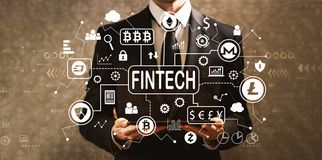 Тема fintech Cryptocurrency при бизнесмен держа таблетку c стоковое фото