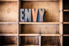 Тема Letterpress концепции завистливости деревянная стоковые фото