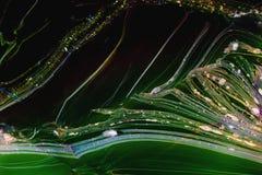 Темная ая-зелен вода с линиями и брызгами Стоковое фото RF