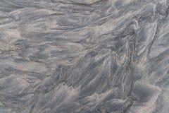 Темная вулканическая текстура песка Стоковая Фотография RF