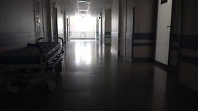 Темная длинная прихожая с медицинской каталкой видеоматериал