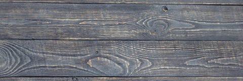 Темная предпосылка деревянной текстуры всходит на борт с выпарками краски горизонтально narrow стоковое фото rf