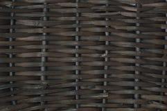 Темная плетеная текстура как предпосылка Стоковые Фото