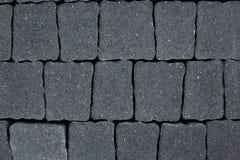 Темная серая мостоваая тротуара Стоковые Фото