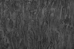 Темная серая текстурированная поверхность, стена, декоративный гипсолит Стоковые Изображения RF