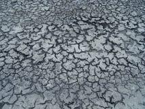 Темная треснутая земля глины Стоковая Фотография