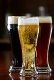 Темное, красное и светлое пиво стоковые фото