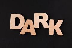 Темнота слова на черной предпосылке Стоковое Изображение RF