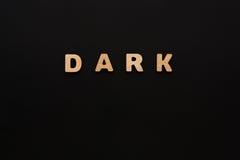 Темнота слова на черной предпосылке Стоковая Фотография RF