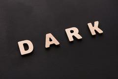Темнота слова на черной предпосылке Стоковые Фотографии RF