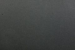 Темнота текстуры - серая бумага Стоковое Изображение