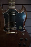 Темнота тела гитары крупного плана электрическая Стоковое Фото