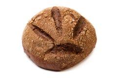 темнота хлеба коричневая грубая меля кругом Стоковые Фото