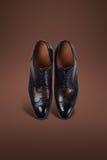 Темные ботинки замши людей Стоковые Изображения RF