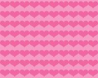 Темные розовые сердца валентинки на более светлой розовой предпосылке Стоковое Изображение RF