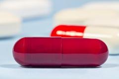Темный - красная трудная капсула Дженерики Стоковое Фото