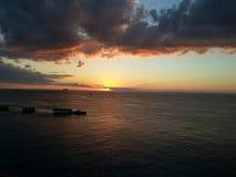 Темный - оранжевый заход солнца Стоковые Изображения