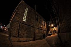 Темный переулок города на ноче Стоковое фото RF