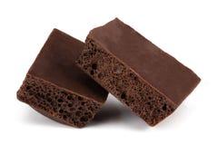 Темный пористый шоколад изолированный на белой предпосылке Стоковое фото RF