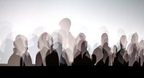 Тени людей на белой стене Стоковое Фото