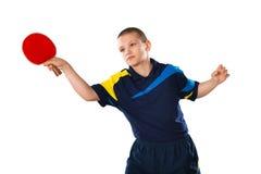 Теннисист мальчика в игре на белой предпосылке стоковое изображение