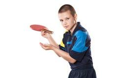 Теннисист мальчика в игре на изолированной белизне стоковые изображения