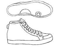 Теннисная обувь на белой предпосылке Стоковое Фото